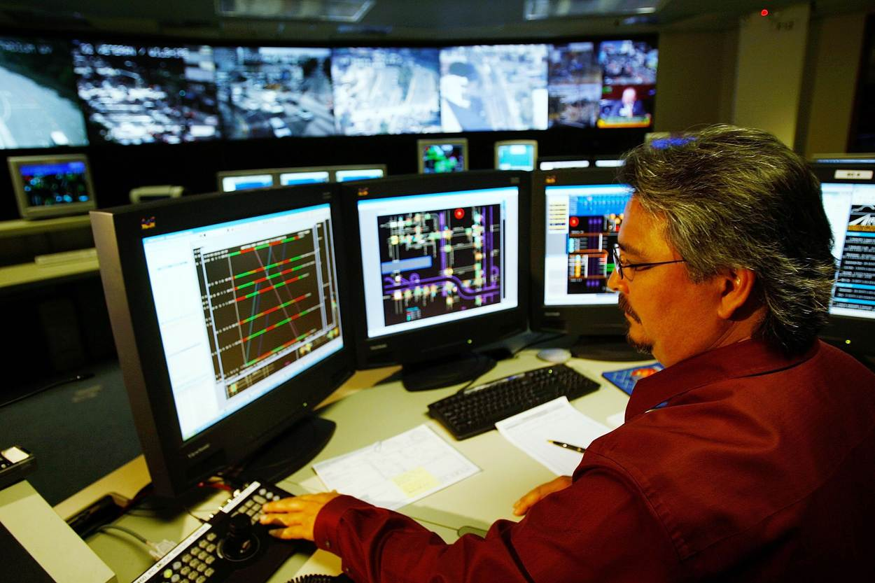 Man supervising monitors in a control room